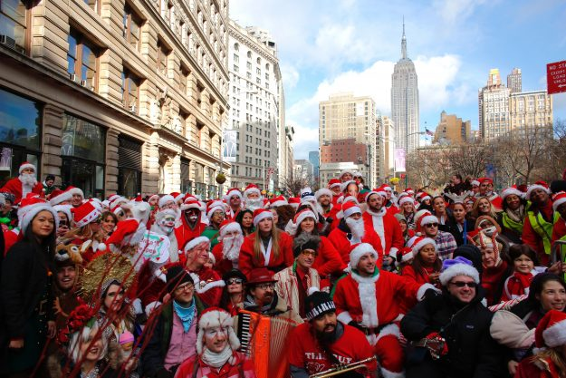 Crowds gather to take part in SantaCon in New York City.