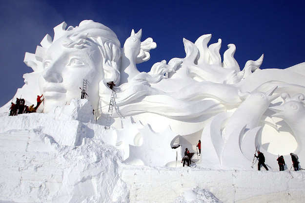 Artists carve the 103-meter-long snow sculpture 'Long Song' for the 29th Harbin International Snow Sculpture Art Expo at Sun Island on December 13, 2016 in Harbin, Heilongjiang Province of China. The 103-meter-long, 31-meter-tall snow sculpture 'Long Song' welcomes tourists at the 29th Harbin International Snow Sculpture Art Expo which will official open on Dec 20.