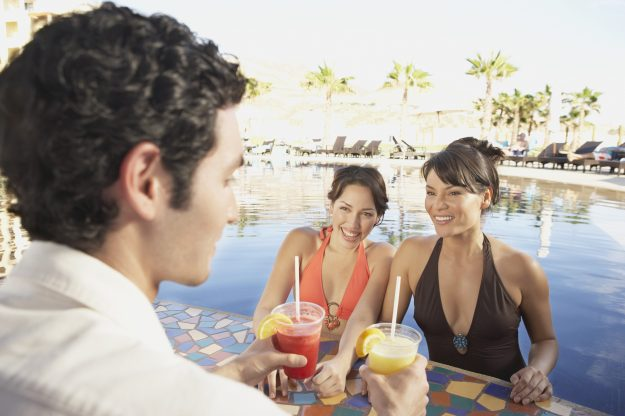 Be careful when charging poolside drinks and snacks to your room. Image: Plush Studios/Bill Reitzel