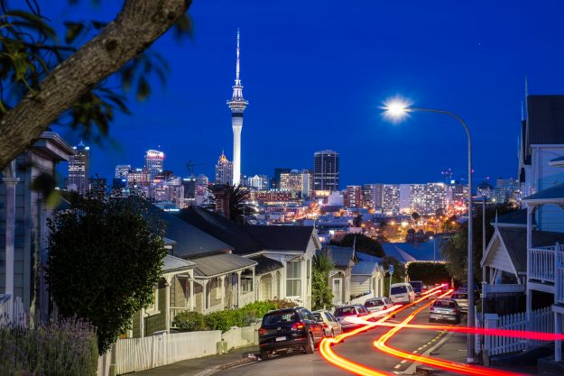 Auckland city at dusk with the Sky Tower in the background. Image: Jose Antonio Maciel/Getty Images