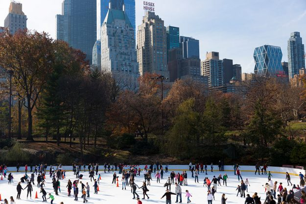 New Yorkers ice skating at the Wollman Memorial Rink in Central Park, New York.