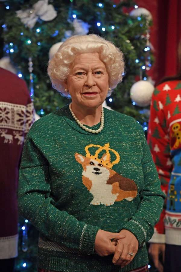 The Queen wears a specially made corgi themed knit.