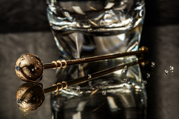 A set of 18-karat gold swizzle sticks set with white and blue diamonds worth a total of USD 1 million.
