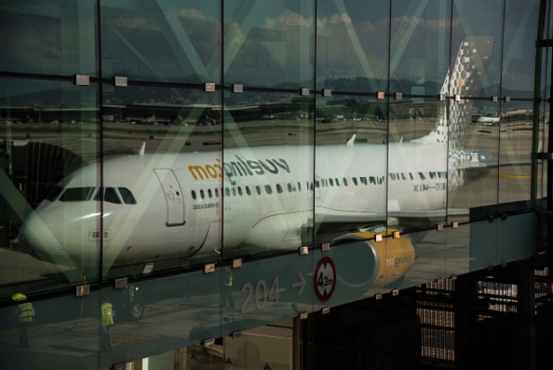Reflection of a Vueling Airbus 320 airplane in El Prat Airport, Barcelona, Spain.