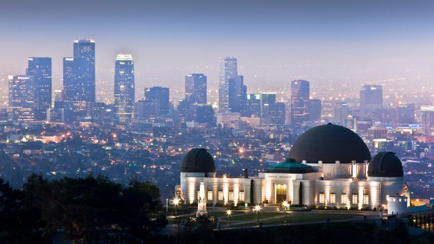View of Griffith Observatory with downtown Los Angeles skyline in background. Image: Andrew Kennelly/Getty Images
