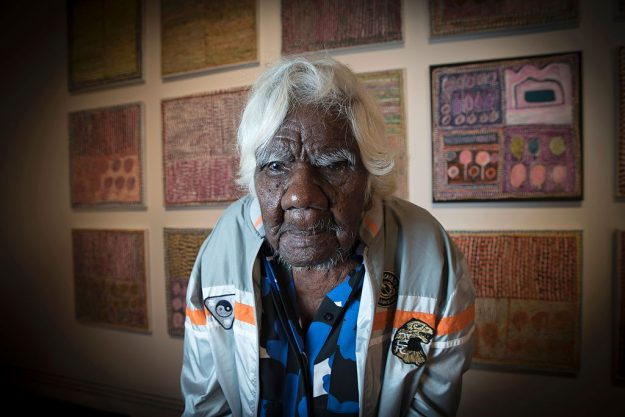 Aboriginal artist Loongkoonan, now thought to be 105, poses in front of some of her artwork. Image: David Mariuz/AFP/Getty Images