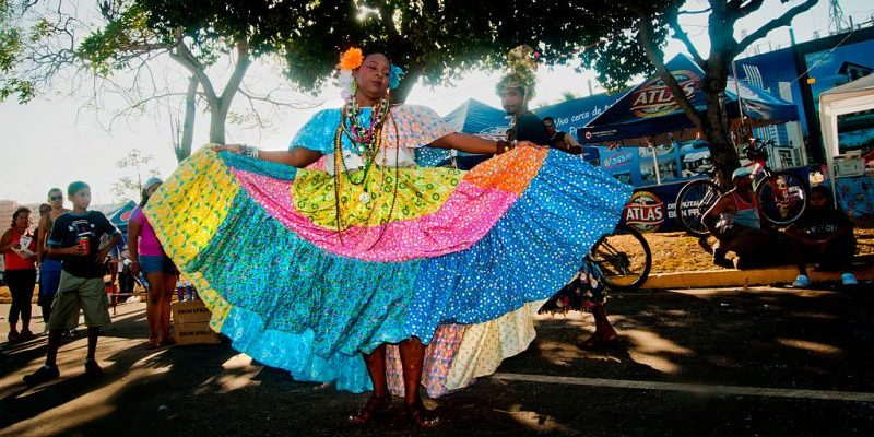 Woman celebrating the Panama City Carnival, 'La Jumbo Rumba', wearing a traditional pollera.