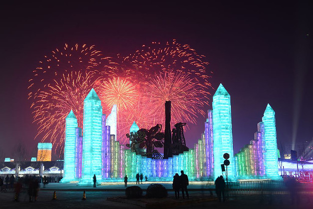 Tourists visit ice sculptures illuminated by coloured lights during the opening ceremony of the 18th Harbin Ice And Snow World as part of the 33rd Harbin International Ice and Snow Festival on January 5.
