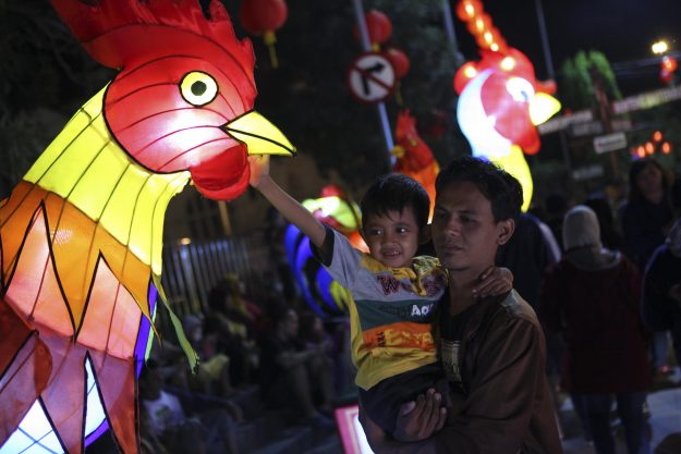 Locals in Surakarta, Indonesia enjoy the various illuminated laterns displayed during a festival to celebrate Chinese Lunar New Year.