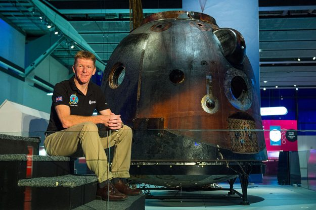 British astronaut Tim Peake with the Russian Soyuz capsule which has gone on display at the Science Museum in London.