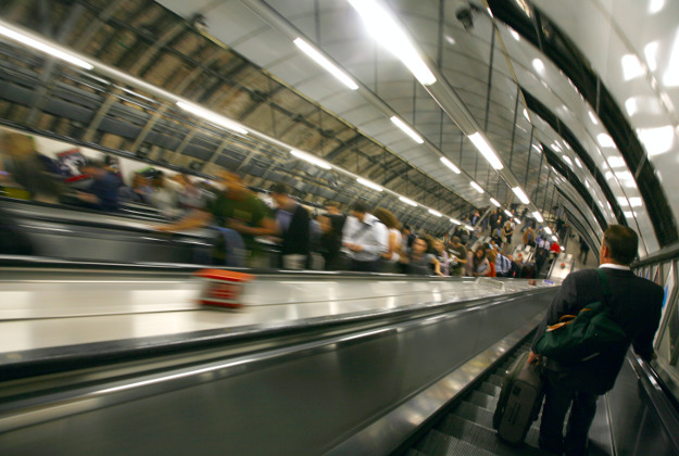 Commuters travelling on the escalators at Holborn Tube Station, London.