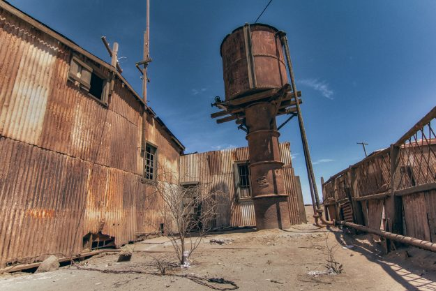 A rusty water tank; much needed for the dry desert.