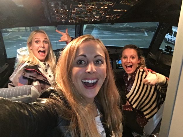 Sarah Hunt, Laura Stevens and Lawrie-Lin Waller in the cockpit of the plane before takeoff.