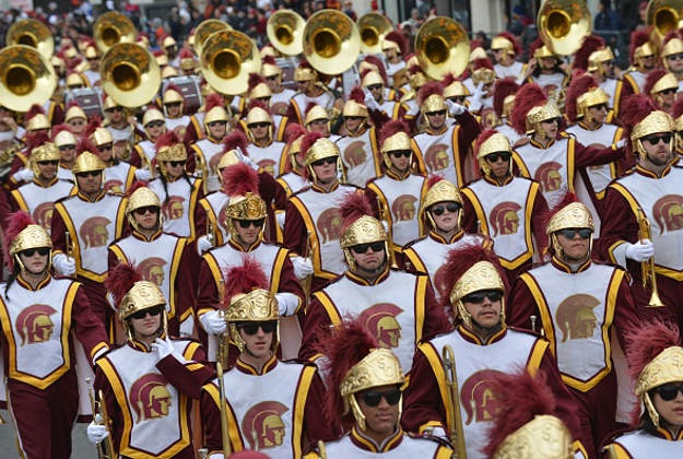 Members of the 103rd Rose Bowl Game participant University of South California (USC) Trojans float and marching band appears during the 128th Rose Parade in Pasadena, California, United States on January 2, 2017.