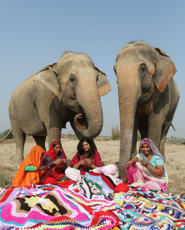 Phoolkali and Laxmi (left) watch while the final touches are completed.
