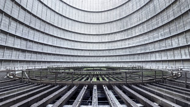 A circular cooling system is seen in an abandoned cooling tower in Belgium.