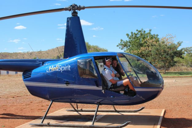 Ana hitching a ride in a helicopter in Australia.