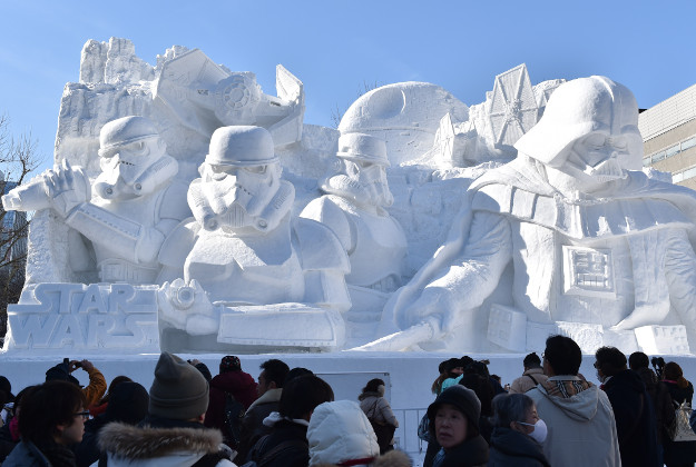 Visitors gather around a large snow sculpture called the snow 'Star Wars' produced by the Japan Ground Self-Defense Force, Sapporo snow festival cooperation group during the 66th annual Sapporo Snow Festival on February 5, 2015