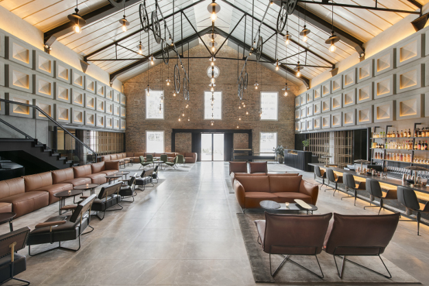 The new hotel is built inside of a warehouse. Warehouse Hotel Singapore