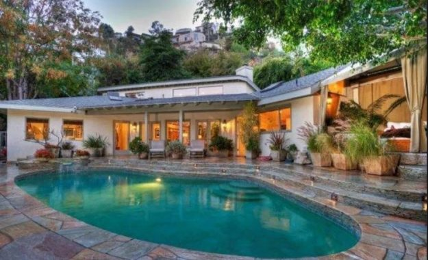 The house features a heated pool and stone deck.