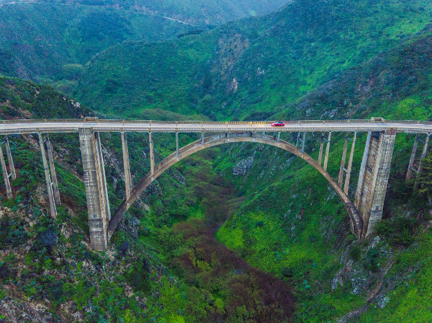 The drama of Bixby Creek's famous deck arch bridge has inspired countless car commercials.