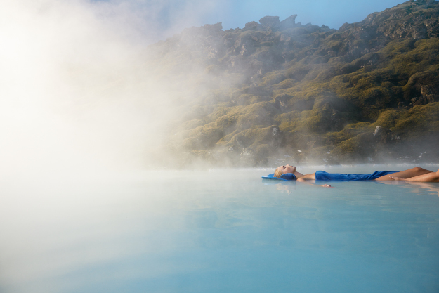A woman relaxes in Blue Lagoon.