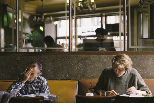 Men reading at the Café Comercial, Madrid.