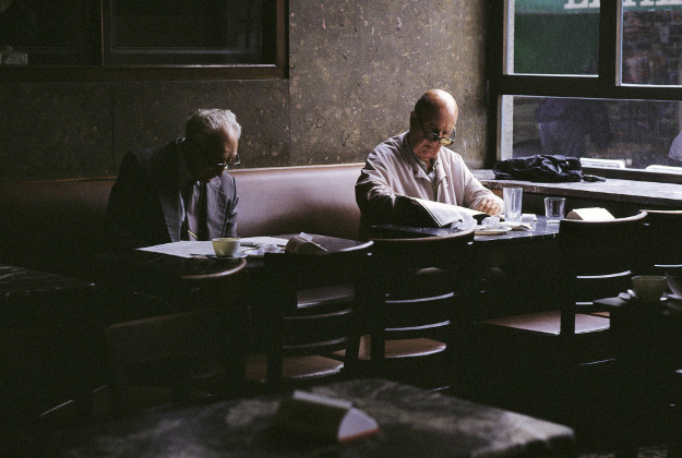 Men reading in the Café Comercial in 2006.