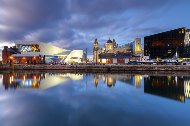 Wide angle view of iconic landmarks on the Liverpool waterfont, taken at dusk. Liverpool, England.