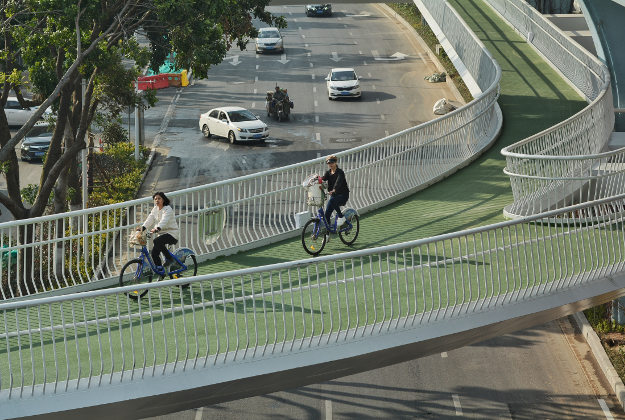 Cyclists ride on China's first elevated bicycle track constructed above the ground in Xiamen city, southeast China's Fujian province, 23 January 2017.
