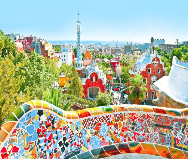The Famous Summer Park Guell over bright blue sky in Barcelona, Spain.