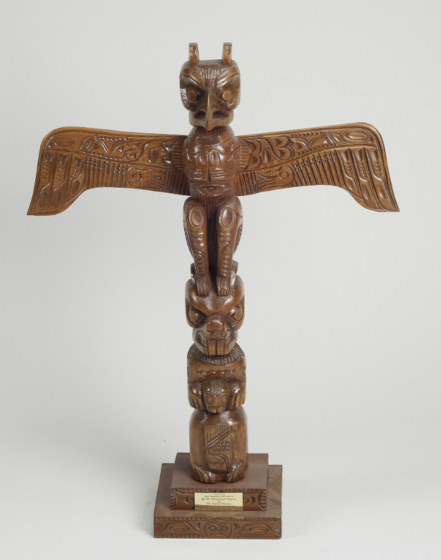 This totem pole, carved by the First Nations of Canada's north-west coast, features the mythical thunderbird at the top, with its wings outstretched. The Thunderbird is believed to bring thunder by flapping its wings.