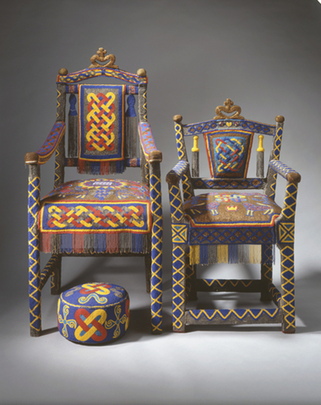 This throne is one of a pair presented to The Queen by the Yoruba people of Nigeria in 1956. Beadwork and royalty are closely associated in Yoruba culture, and large quantites are considered a sign of wealth and status.