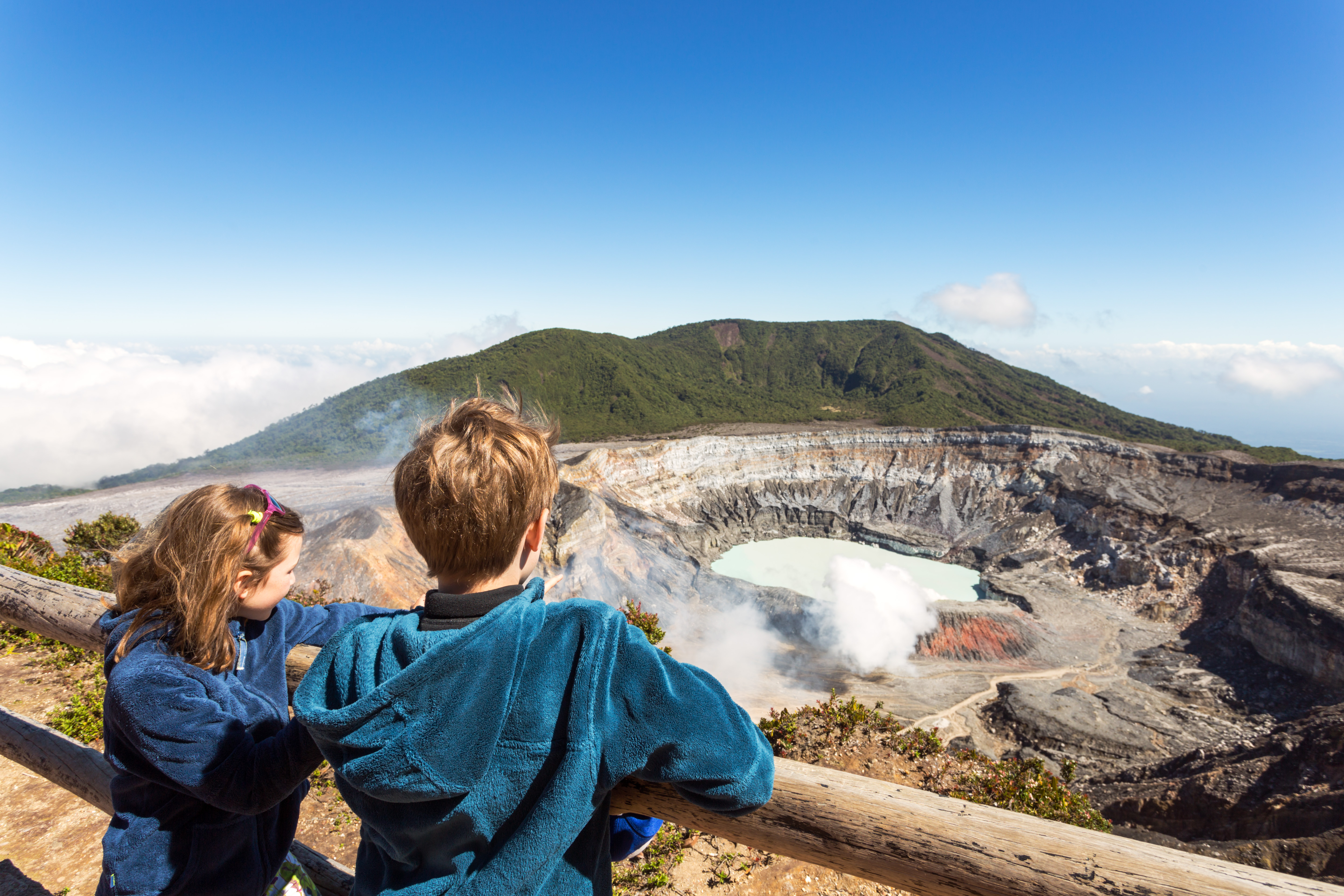 Two children looking into a volcano crater. Image by Matteo Colombo/Getty Images