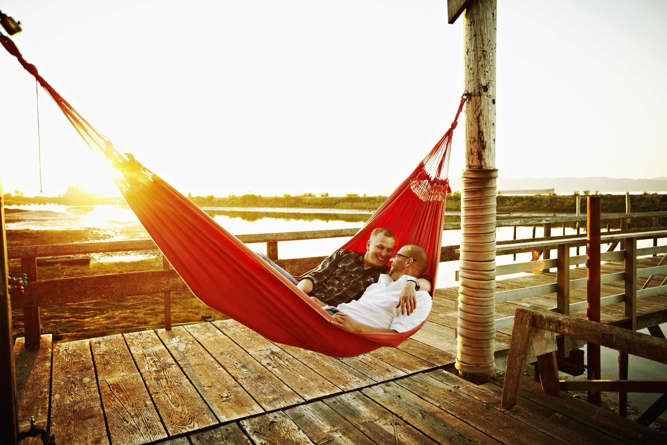 Couple relax in a hammock during a romantic getaway