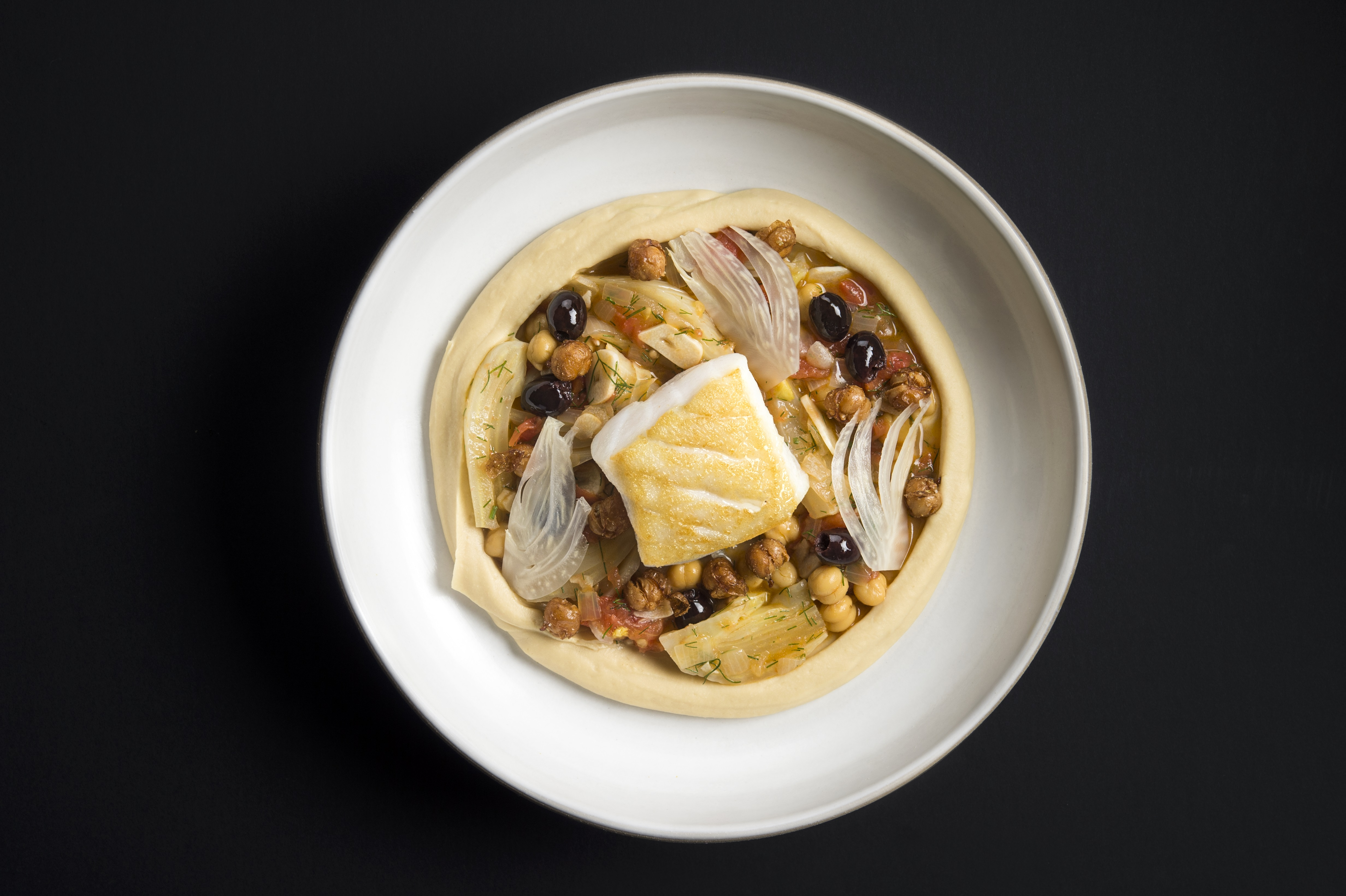 Cod provencal is one of the affordable meals at a new casual restaurant from the chef behind Eleven Madison Park.