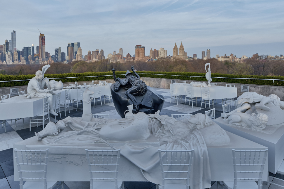 3-D exhibition on the roof of the Met with New York in the background.