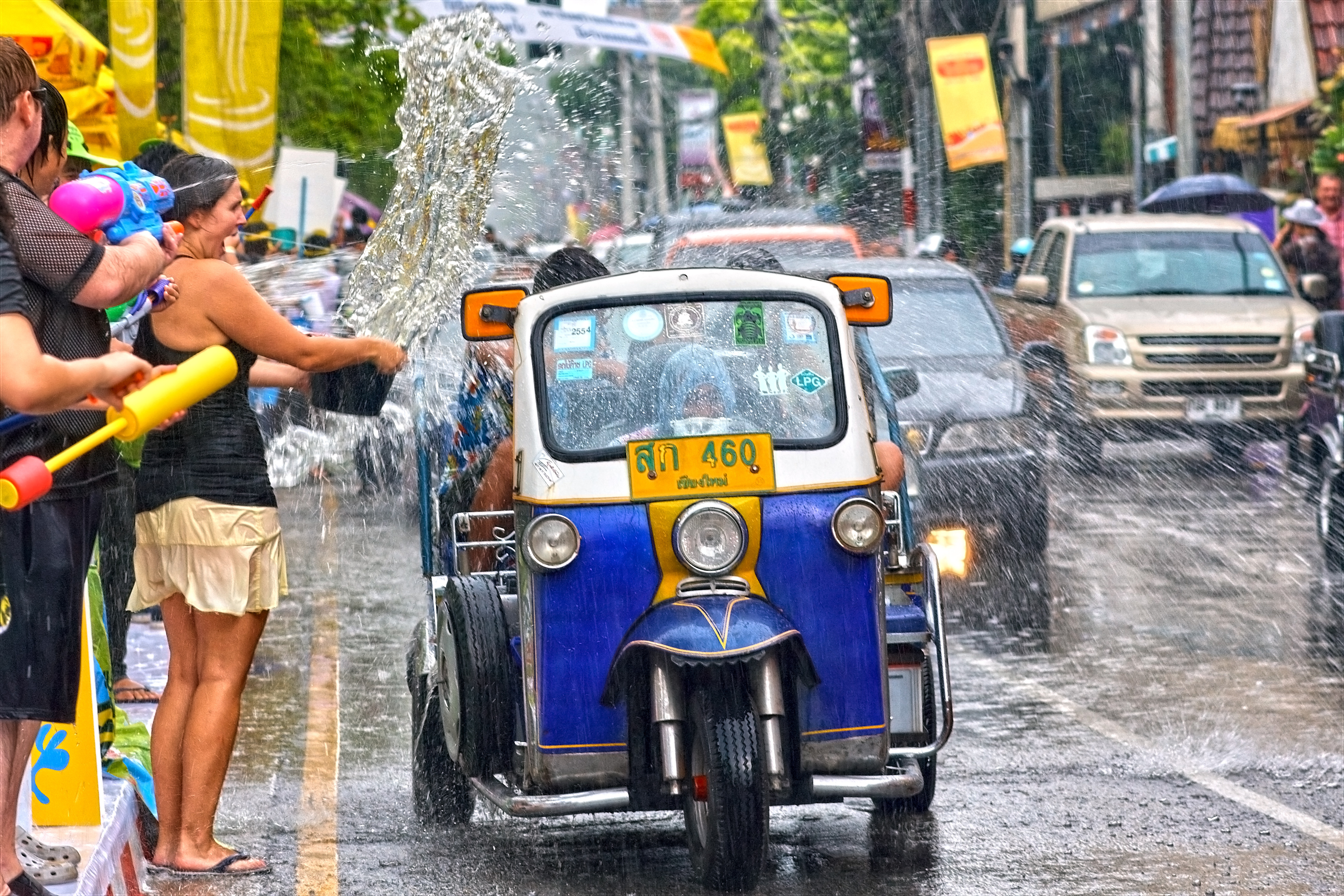 Tuk Tuk being doused with water at Songkran Festival.Chiang Mai, Chiang Mai, Thailand, South-East Asia, Asia