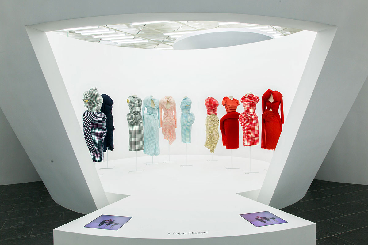 Navy, blue pink and red dresses on mannequins.