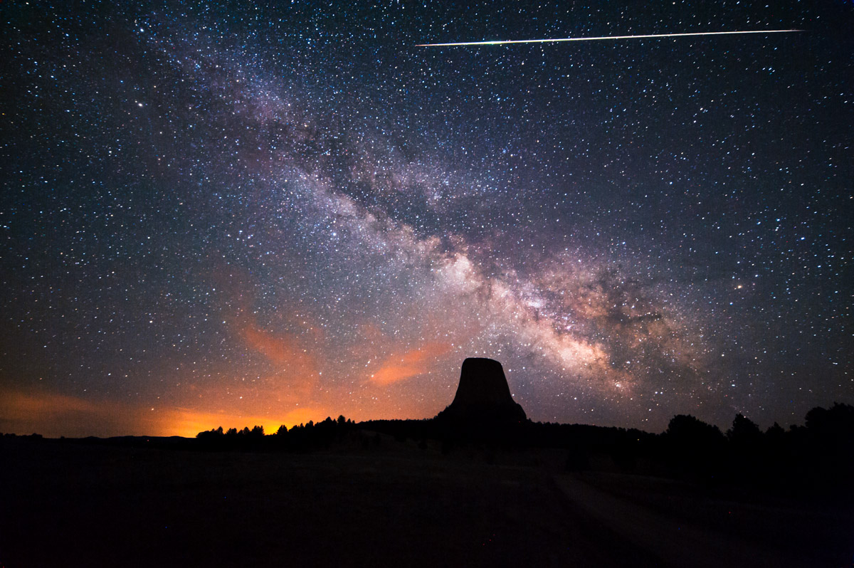 A giant meteor streak across the sky over Devil's Tower, Wyoming, USA