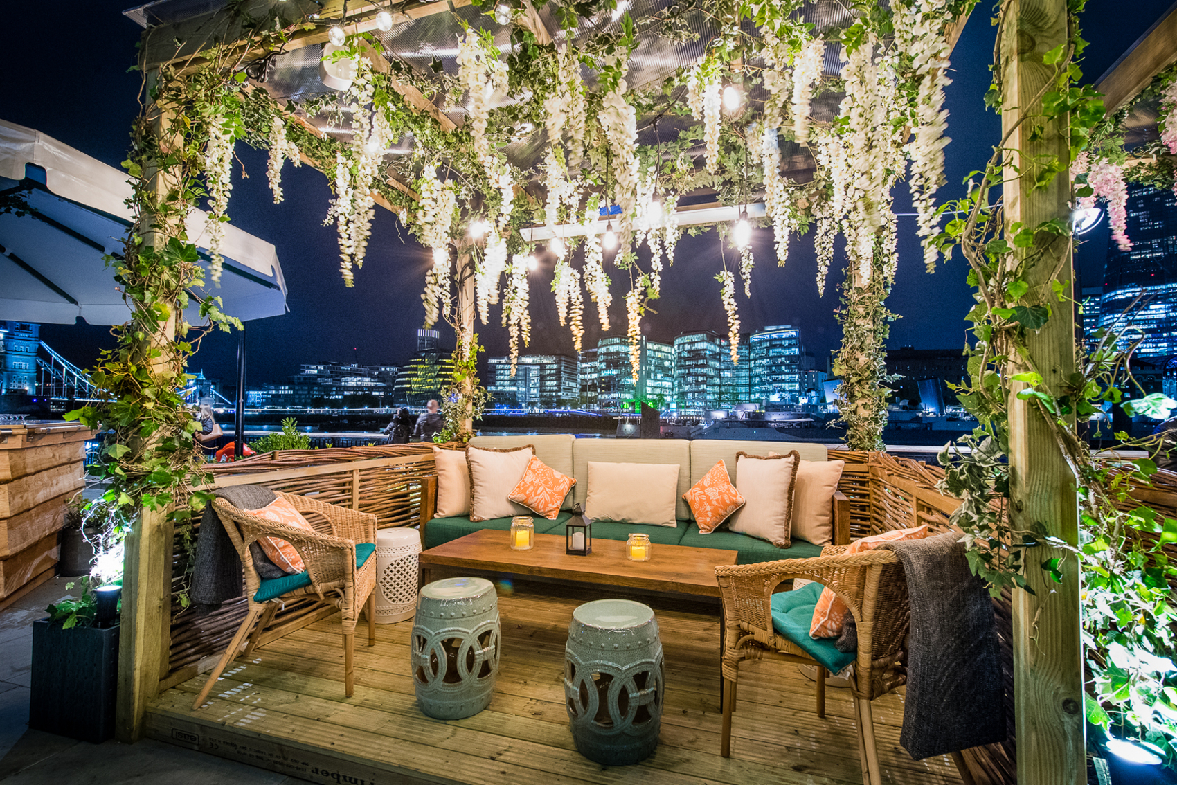A coppa club cabana at night time that can be rented on the river thames