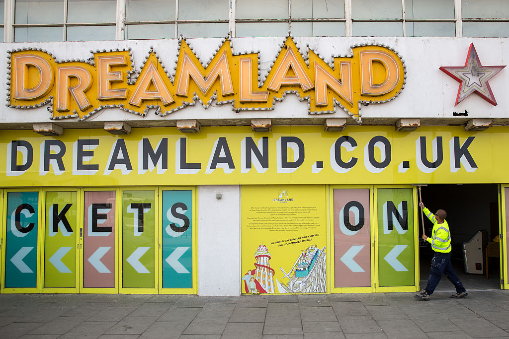 Workers paint the front of Dreamland