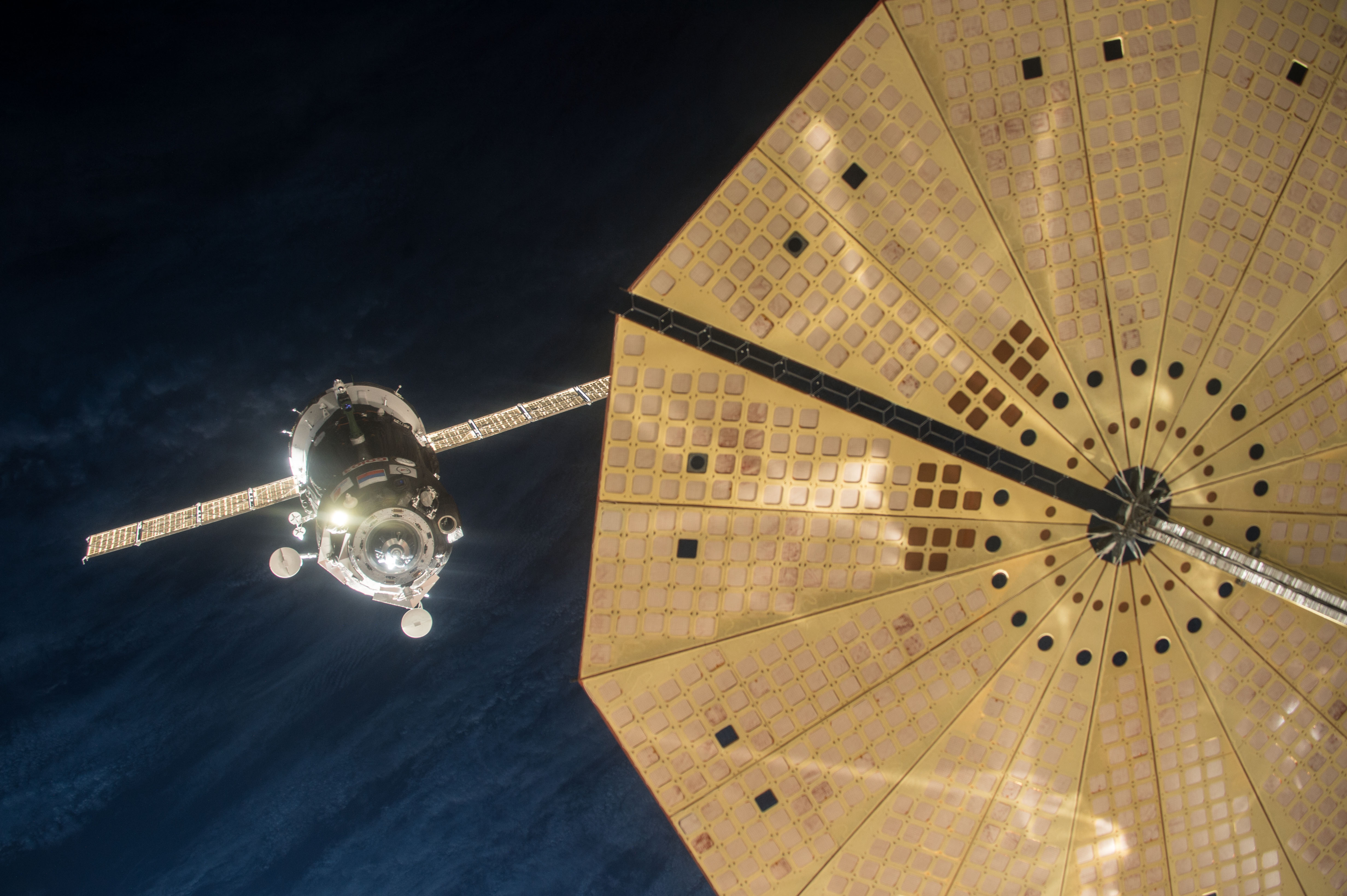 Soyuz TMA-19M spacecraft manually docks with the International Space Station (ISS) December 15, 2015 in space.