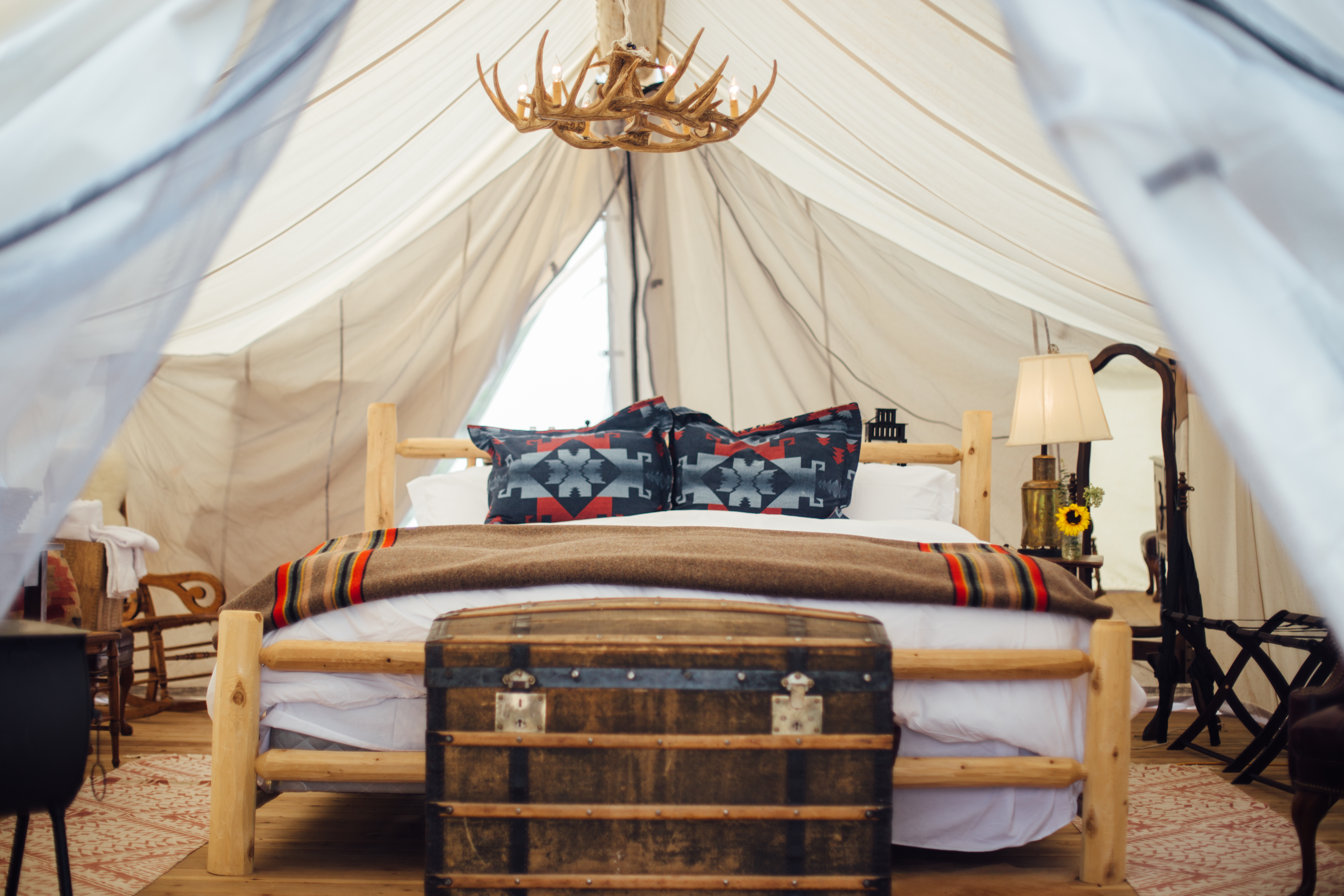 A luxury tent in Vail, Colorado for glamping featuring Egyptian cotton sheets