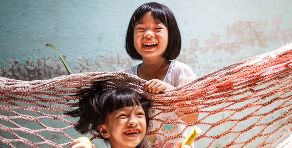 Children playing with fishing nets.