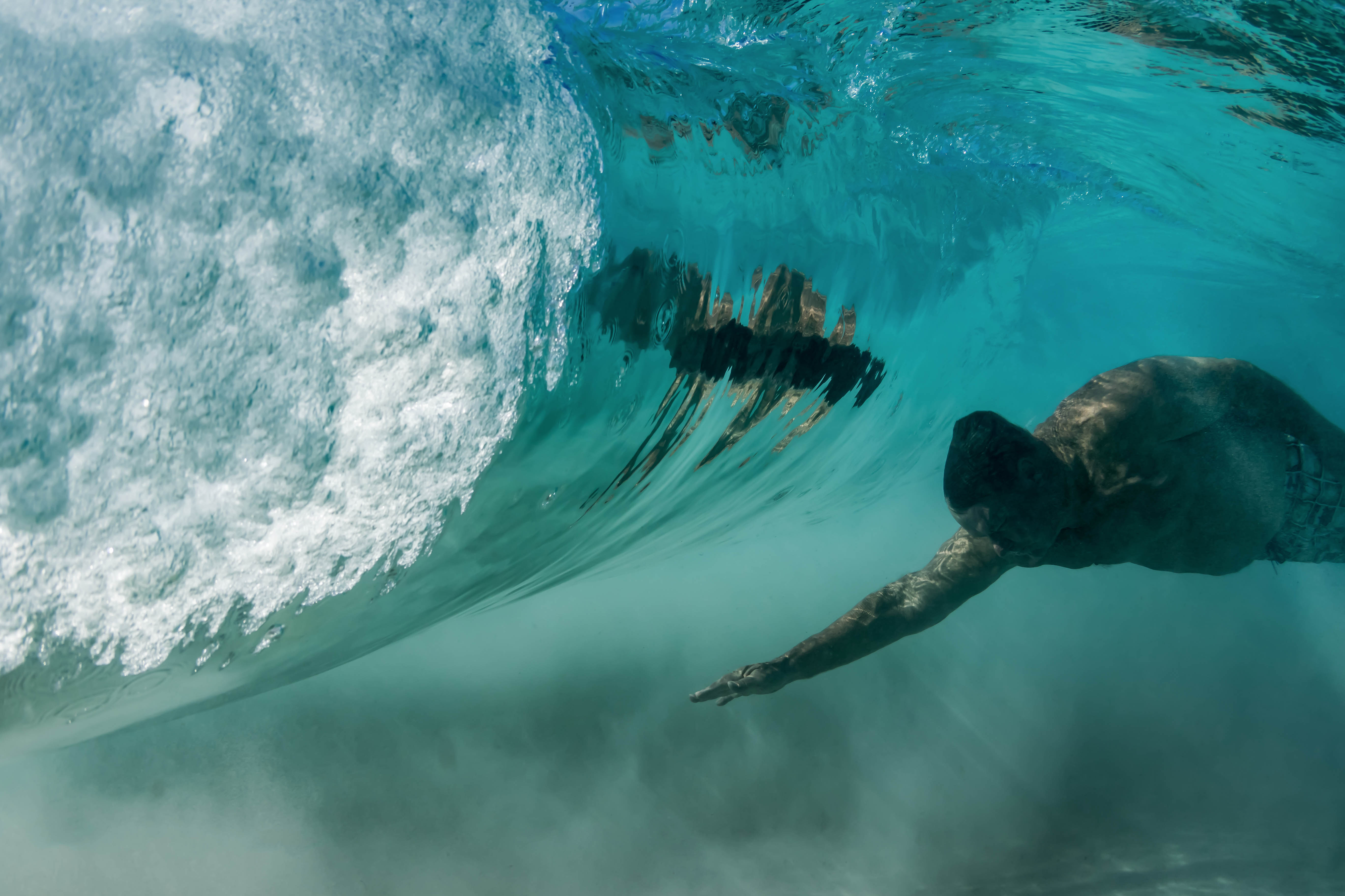 The stunning underwater shots show violent vortices venting from a breaking wave.