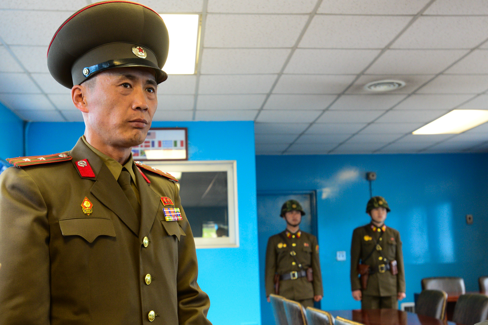 A North Korean officer and soliders stand guard at the old negotiation room at the De-Militarized Zone on the border with South Korea.