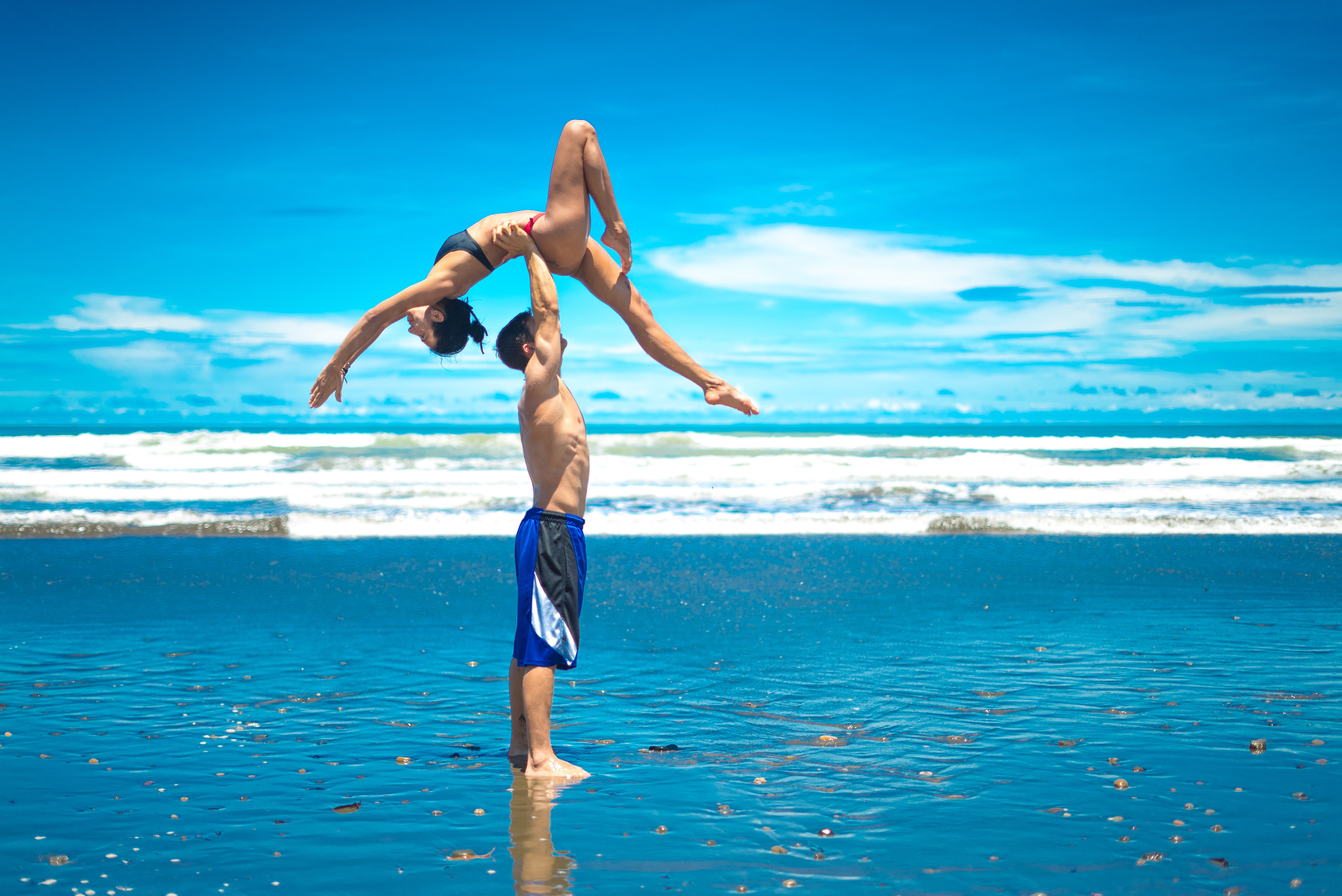 The incredible pictures show the husband and wife team balancing on each other to pull some impressive shapes on the beach.