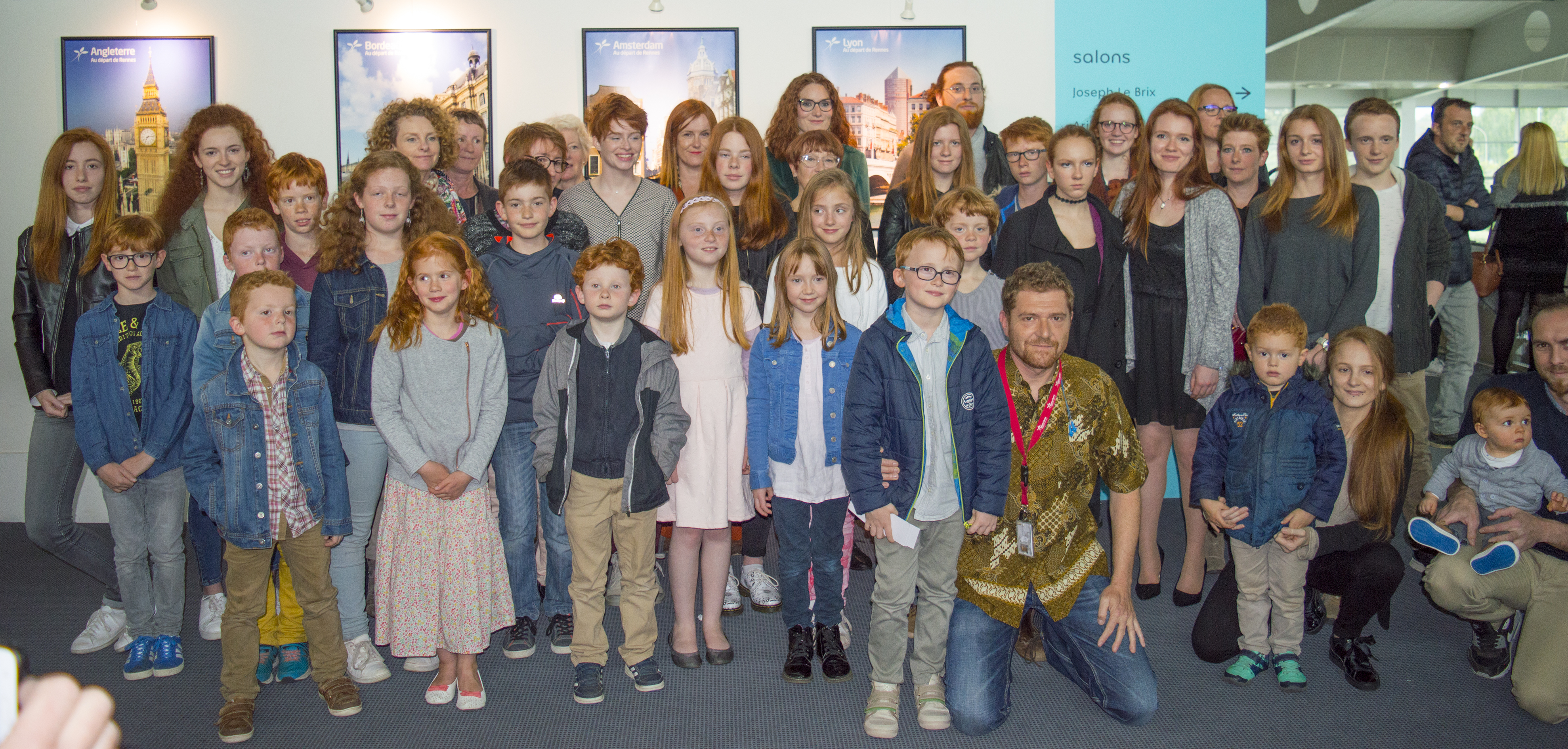 Photographer Pascal Sacleux with the subjects of his series, pictured at the exhibition at Rennes Airport.