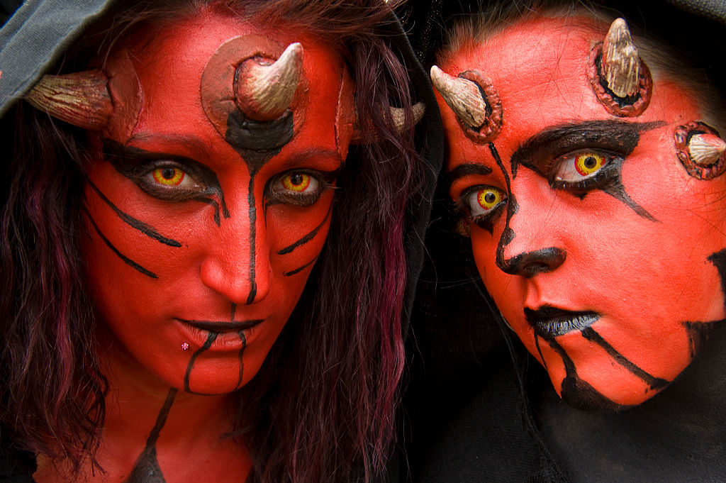 People wearing a Dark Maul costume takes part in a Star Wars convention in Cusset